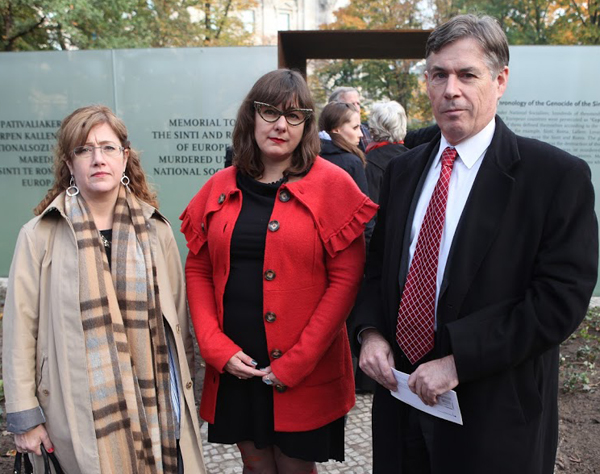 Erika Schlager, Counsel for International Law of the U.S. Commission on Security and Cooperation in Europe, Prof. Ethel Brooks, a representative of American Roma and Special Envoy for Holocaust Issues Douglas Davidson in front of the memorial.